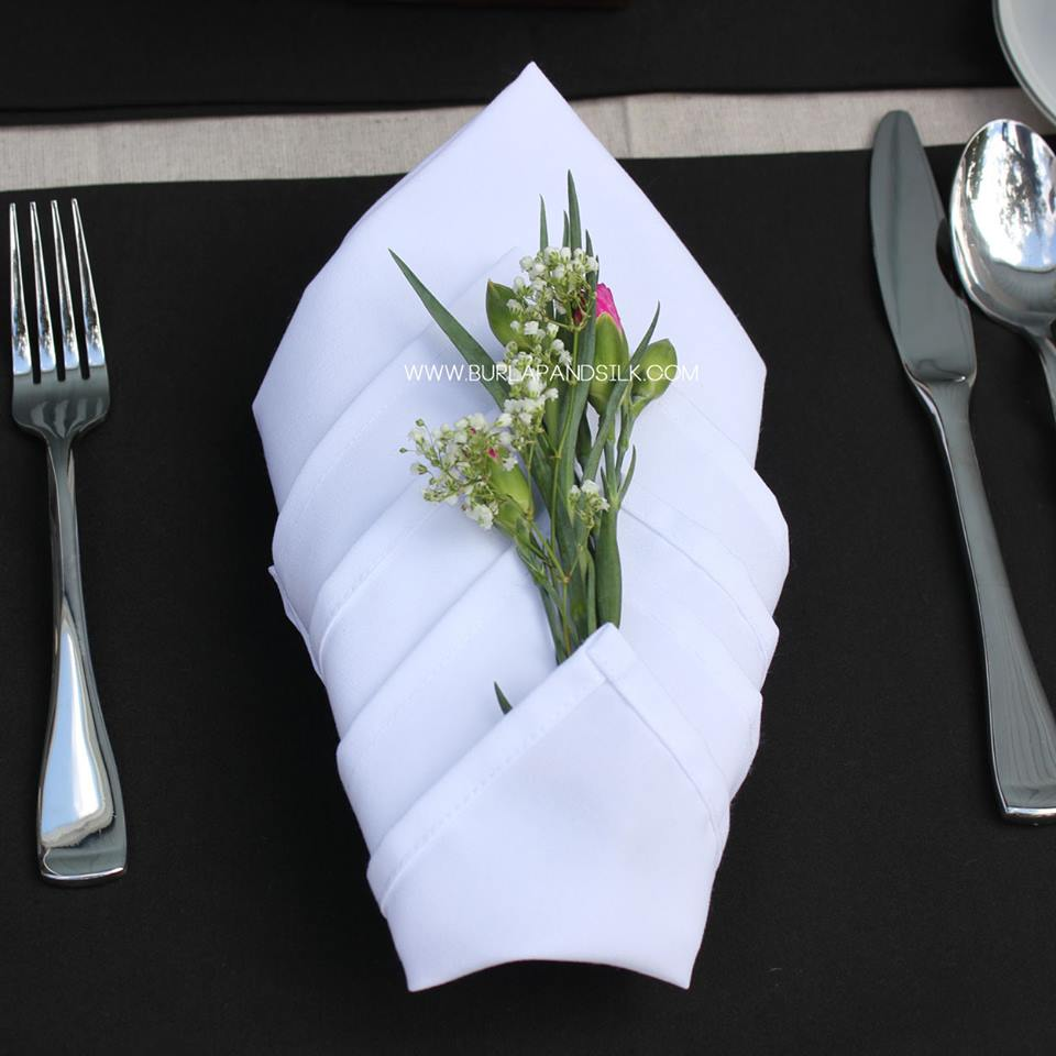 Napkin-Folding Styles | White Napkins and Black Placemats